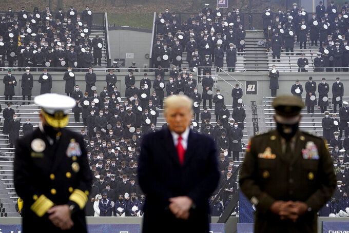 President Donald Trump pauses as he stands on the field before the start of the 121st Army-Navy Football Game in Michie Stadium at the United States Military Academy, Saturday, Dec. 12, 2020, in West Point, N.Y. (AP Photo/Andrew Harnik)