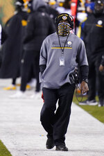 Pittsburgh Steelers head coach Mike Tomlin watches the second half of an NFL football game against the Cincinnati Bengals, Monday, Dec. 21, 2020, in Cincinnati. (AP Photo/Bryan Woolston)