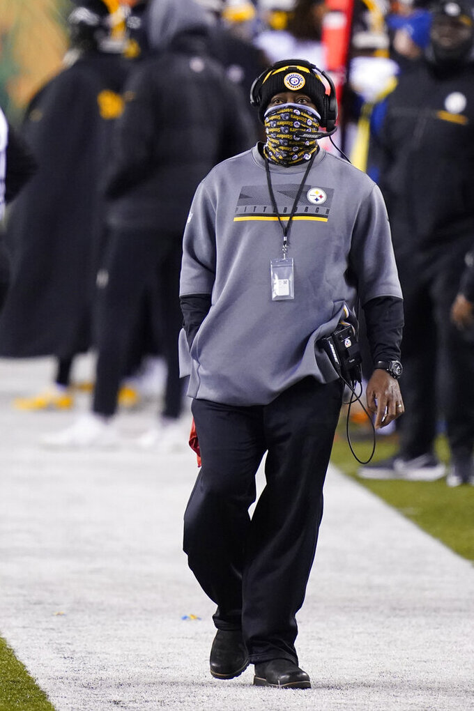 Pittsburgh Steelers head coach Mike Tomlin watches the second half of an NFL football game against the Cincinnati Bengals, Monday, Dec. 21, 2020, in Cincinnati. (AP Photo/Bryan Woolston)