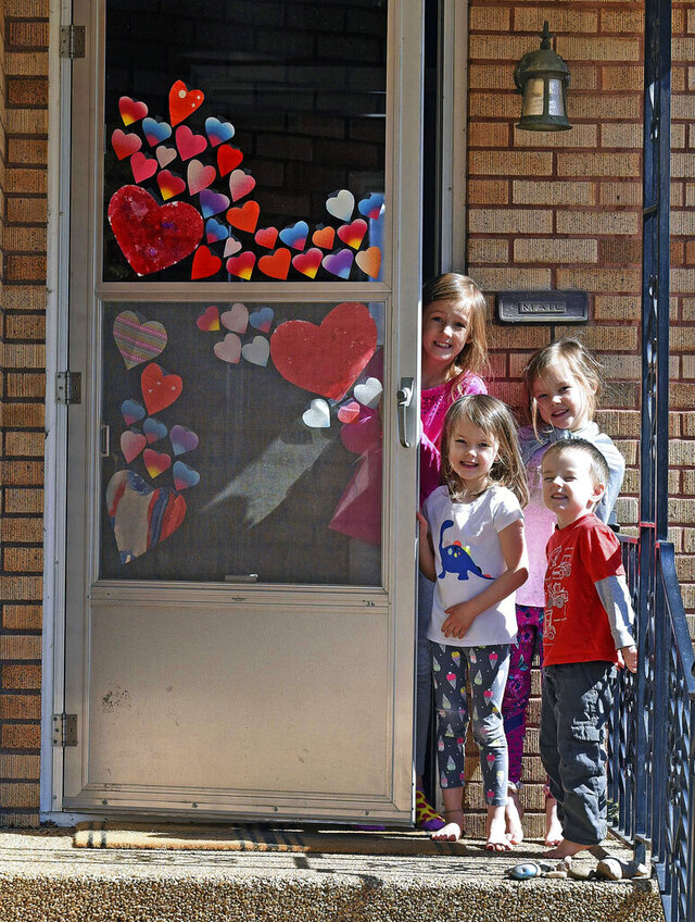 Tribune Hearts were everywhere on the Kennelly home and many other doors and windows in the Bismarck Mandan area Monday, March 24, 2020as a grassroots group called #aworldofhearts sweeping the nation in response to the COVID-19 sheltering happening in many cities across the country. Showing their heart covered front door are from left Maria, 8, Evelyn, 5, Frannie, 7, and Jack, 3.
