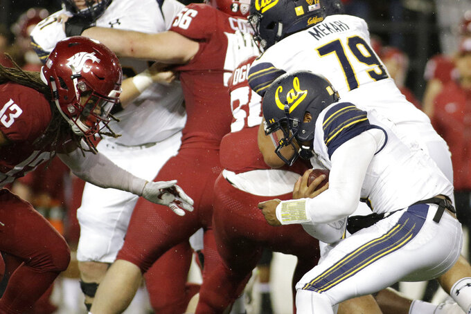 California quarterback Brandon McIlwain, right, runs with the ball while defended by Washington State linebacker Jahad Woods (13) during the second half of an NCAA college football game in Pullman, Wash., Saturday, Nov. 3, 2018. Washington State won 19-13. (AP Photo/Young Kwak)