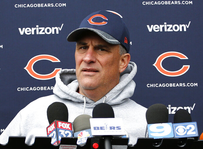 FILE - In this May 14, 2016, file photo, Chicago Bears defensive coordinator Vic Fangio talks to media after the team's NFL rookie minicamp football practice in Lake Forest, Ill. Fangio is returning to the Bears as their defensive coordinator after being passed up for their head coaching job. Fangio re-signed Friday, Jan.12, 2018, and will continue to lead a defense he helped transform the past three seasons. (AP Photo/Nam Y. Huh, File)