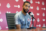 FILE - In this Nov. 13, 2019, file photo, Toronto FC soccer player Justin Morrow speaks to the media during an end of season availability in Toronto. A group of African American Major League Soccer players have formed a coalition to address systematic racism in their communities and bring about change within the league. The coalition is the result of an Instagram group formed after the death of George Floyd at the hands of Minneapolis police, which spawned a wave of nationwide protests against racism and policy brutality. Started by Toronto FC defender Justin Morrow, the group grew to some 70 MLS players, who decided to act and the Black Players Coalition of MLS was born. (Chris Young/The Canadian Press via AP, File)