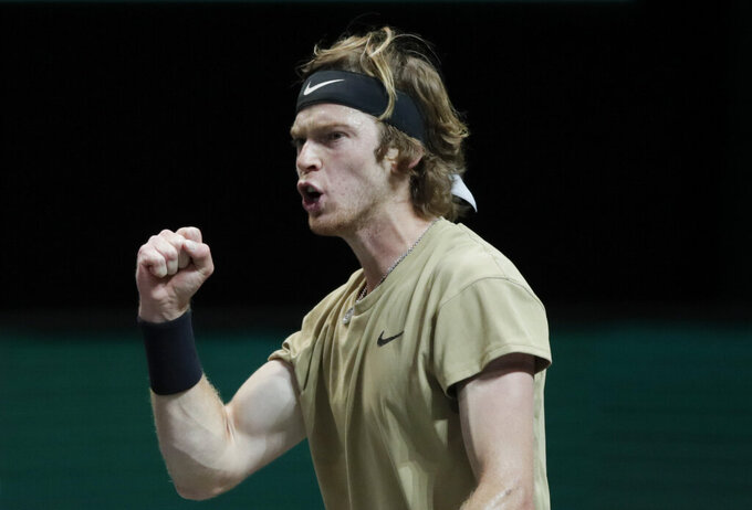 Russia's Andrey Rublev clenches his fist after winning the first set against Hungary's Marton Fucsovics in the final men's singles match of the ABN AMRO world tennis tournament at Ahoy Arena in Rotterdam, Netherlands, Sunday, March 7, 2021. (AP Photo/Peter Dejong)