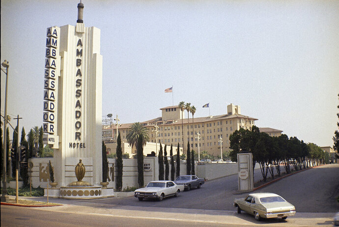 FILE - This June 28, 1968, file photo, shows the main entrance to the Ambassador Hotel in Los Angeles, Calif. The Ambassador Hotel, where presidents slept, Robert Kennedy was assassinated in 1968 and Mary Pickford collected her Oscar for best actress in 1930 is now the site of a public-school complex. Opened in 1921 and designed by Myron Hunt, with later renovations by African American architect Paul Revere Williams, the Ambassador Hotel was one of Los Angeles' defining historic sites. The archive of the late African American architect Paul Revere Williams has been acquired by the University of Southern California School of Architecture and the Getty Research Institute. (AP Photo/David F. Smith, File)