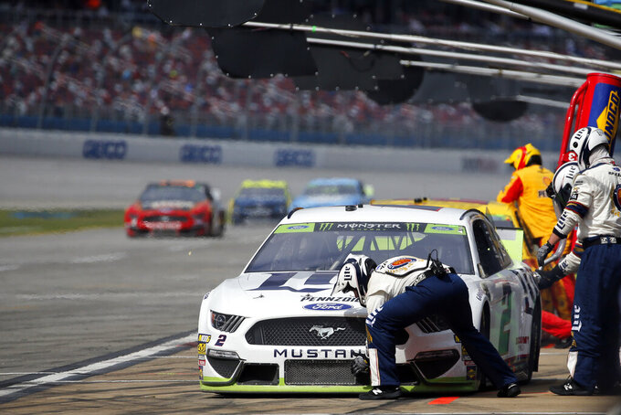 Brad Keselowski (2) stops for a refueling during a NASCAR Cup Series auto race at Talladega Superspeedway, Monday, Oct 14, 2019, in Talladega, Ala. (AP Photo/Butch Dill)
