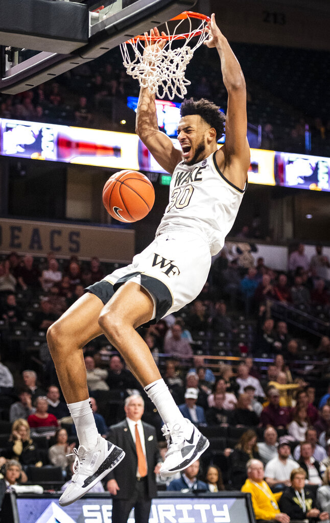 Wake Forest center Olivier Sarr (30) dunks during an NCAA college basketball game against Virginia Tech Tuesday, Jan. 14, 2020 in Winston-Salem, N.C. (Andrew Dye/Winston-Salem Journal via AP)