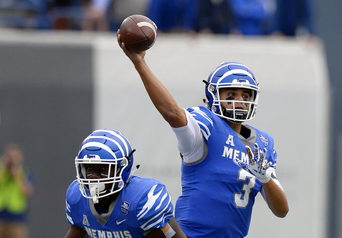 Memphis quarterback Brady White (3) passes against Central Florida during the first half of an NCAA college football game Saturday, Oct. 13, 2018, in Memphis, Tenn. (AP Photo/Mark Zaleski)