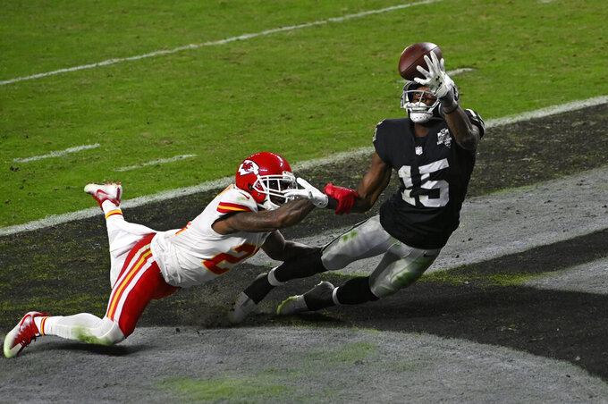 Las Vegas Raiders wide receiver Nelson Agholor (15) misses a catch beside Kansas City Chiefs cornerback Bashaud Breeland (21) during the second half of an NFL football game, Sunday, Nov. 22, 2020, in Las Vegas. (AP Photo/David Becker)