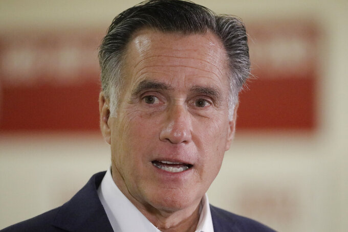 Utah Sen. Mitt Romney speaks during a news conference at the University of Utah Friday, Nov. 15, 2019, in Salt Lake City. Romney says he supports efforts to allow college athletes to profit from their name and image because he wants to help poor students who may never become professional athletes. Romney made his comments in Salt Lake City after a discussing the topic with athletic directors from Utah colleges. (AP Photo/Rick Bowmer)