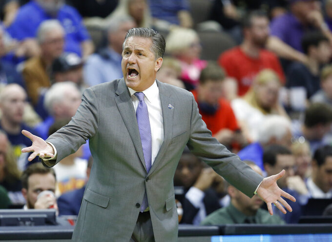 Kentucky head coach John Calipari questions a ruling by an official during the first half against Wofford in a second-round game in the NCAA men's college basketball tournament in Jacksonville, Fla., Saturday, March 23, 2019. (AP Photo/Stephen B. Morton)