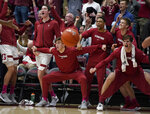 Stanford players on the bench celebrate a basket against Oregon during the second half of an NCAA college basketball game Saturday, Feb. 1, 2020, in Stanford, Calif. Stanford won 70-60. (AP Photo/Tony Avelar)
