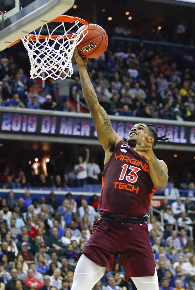 Virginia Tech guard Ahmed Hill (13) scores an open basket against Duke during the first half of an NCAA men's college basketball tournament East Region semifinal in Washington, Friday, March 29, 2019. (AP Photo/Alex Brandon)