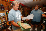 This Aug. 8, 2019, photo shows Bigfoot researcher David Bakara opening a box containing plaster cast of footprints said to be from a Russian Bigfoot at Expedition: Bigfoot! The Sasquatch Museum in Cherry Log, Ga.  Bakara, a longtime member of the Bigfoot Field Researchers Organization who served in the Navy, drove long-haul trucks and tended bar before opening the museum in early 2016 with his wife, Malinda. (AP Photo/John Bazemore)