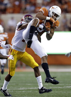 Texas wide receiver Collin Johnson (9) pulls down a pass in front of Southern California safety Marvell Tell III (7) during the first half of an NCAA college football game, Saturday, Sept. 15, 2018, in Austin, Texas. (AP Photo/Eric Gay)