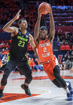 Illinois forward Kipper Nichols (2) drives while being guarded by Michigan State forward Xavier Tillman (23) during the first half of an NCAA college basketball game in Champaign, Ill., Tuesday, Feb. 5, 2019. (AP Photo/Rick Danzl)