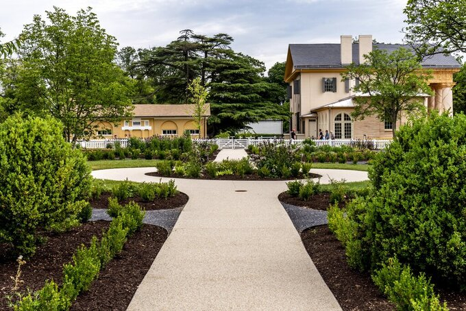 Arlington House, The Robert E. Lee Memorial, formerly named the Custis-Lee Mansion, as seen from the flower garden, reopens to the public for the first time since 2018 at Arlington National Cemetery, Tuesday, June 8, 2021 in Arlington, Va. The Virginia mansion where Robert E. Lee once lived that now overlooks Arlington National Cemetery is open to the public again, after a $12 million rehabilitation and reinterpretation that includes an increased emphasis on those who were enslaved there. (AP Photo/Andrew Harnik)
