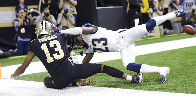 Los Angeles Rams' Nickell Robey-Coleman breaks up a pass intended for New Orleans Saints' Michael Thomas during the second half of the NFL football NFC championship game, Sunday, Jan. 20, 2019, in New Orleans. (AP Photo/Gerald Herbert)