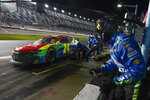 Crew members make repairs after William Byron was involved in a crash during the NASCAR Daytona 500 auto race at Daytona International Speedway, Sunday, Feb. 14, 2021, in Daytona Beach, Fla. (AP Photo/John Raoux)