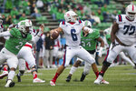 Marshall defensive end Darius Hodge (2) pressures Florida Atlantic quarterback Nick Tronti (6) who attempts to pass during an NCAA college football game Saturday, Oct. 24, 2020, in Huntington, W.Va. (Sholten Singer/The Herald-Dispatch via AP)