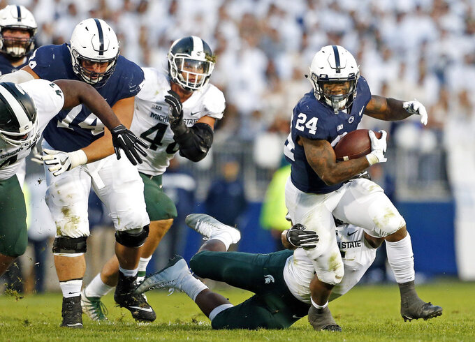 Penn State's Miles Sanders (24) runs the ball against Michigan State during the second half of an NCAA college football game in State College, Pa., Saturday, Oct. 13, 2018. (AP Photo/Chris Knight)