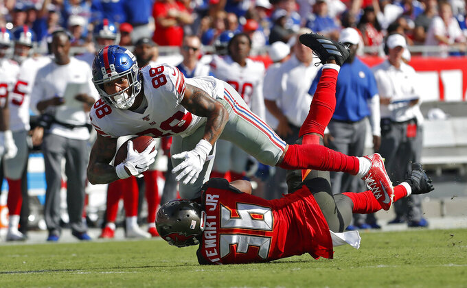 New York Giants tight end Evan Engram (88) runs over Tampa Bay Buccaneers cornerback M.J. Stewart after a reception during the first half of an NFL football game Sunday, Sept. 22, 2019, in Tampa, Fla. (AP Photo/Mark LoMoglio)