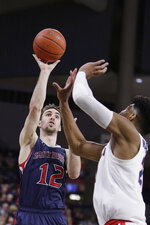 Saint Mary's guard Tommy Kuhse (12) shoots over Gonzaga forward Rui Hachimura (21) during the first half of an NCAA college basketball game in Spokane, Wash., Saturday, Feb. 9, 2019. (AP Photo/Young Kwak)