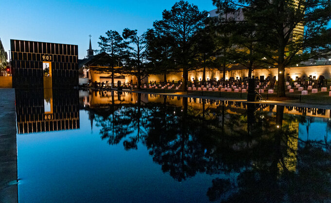 The 9:01 gate is lit during the 26th Anniversary Remembrance Ceremony at the Oklahoma City National Memorial and Museum in Oklahoma City, Okla on Monday, April 19, 2021. (Chris Landsberger/The Oklahoman via AP)
