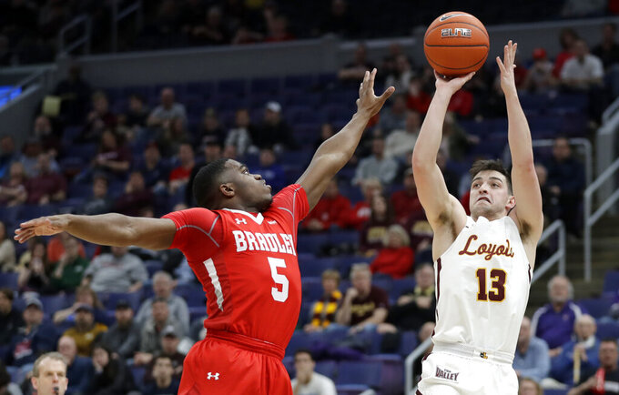 Loyola of Chicago's Clayton Custer (13) shoots over Bradley's Darrell Brown (5) during the first half of an NCAA college basketball game in the semifinal round of the Missouri Valley Conference tournament, Saturday, March 9, 2019, in St. Louis. (AP Photo/Jeff Roberson)