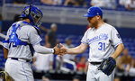 Kansas City Royals relief pitcher Ian Kennedy (31) and catcher Meibrys Viloria (72) celebrate after they defeated the Miami Marlins in a baseball game, Friday, Sept. 6, 2019, in Miami. (AP Photo/Wilfredo Lee)