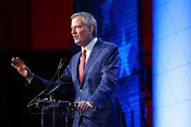 New York City Mayor Bill de Blasio speaks at the ​U.S. Conference of Mayors' Winter Meeting, Wednesday, Jan. 22, 2020, in Washington. (AP Photo/Patrick Semansky)