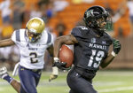 Hawaii wide receiver JoJo Ward (19) catches a pass and runs in for a touchdown as Navy cornerback Jarid Ryan (2) gives up the chase in the second half of an NCAA college football game, Saturday, Sept. 1, 2018, in Honolulu. Hawaii beat Navy 59-41. (AP Photo/Eugene Tanner)