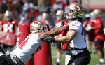 San Francisco 49ers' Solomon Thomas, left, and Nick Bosa perform a drill at the team's NFL football training camp in Santa Clara, Calif., Saturday, July 27, 2019. (AP Photo/Jeff Chiu)