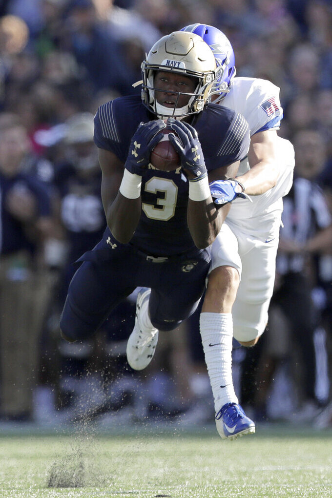 --ALTERNATE CROP TO MDJC101-- Navy wide receiver Mychal Cooper, front, makes a catch on a pass from quarterback Malcolm Perry, not visible, as Air Force defensive back Milton Bugg III defends during the first half of an NCAA college football game Saturday, Oct. 5, 2019, in Annapolis, Md. (AP Photo/Julio Cortez)