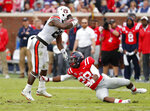 Auburn running back JaTarvious Whitlow (28) avoids a tackle by Mississippi defensive back Cam Ordway (28) during the first half of an NCAA college football game on Saturday, Oct. 20, 2018, in Oxford, Miss. (AP Photo/Rogelio V. Solis)