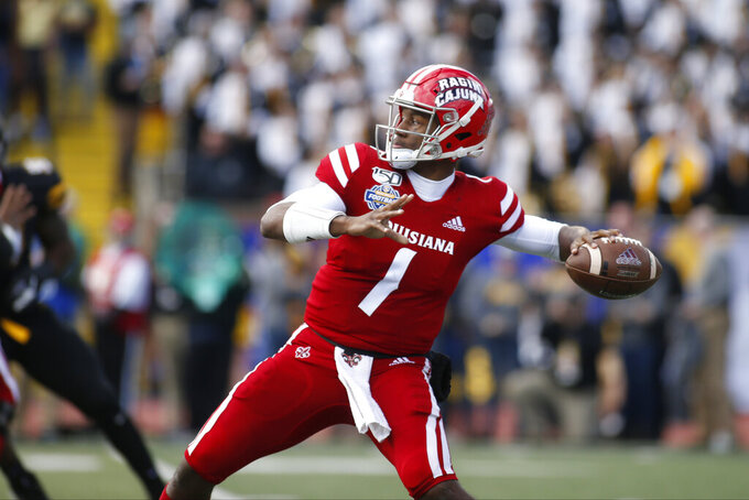 Louisiana-Lafayette quarterback Levi Lewis (1) throws a pass during the first half of an NCAA college football game in the Sun Belt Football Championship against Appalachian State on Saturday, Dec. 7, 2019, in Boone, N.C. (AP Photo/Brian Blanco)