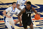 Butler's Bo Hodges (1) spins away from Creighton's Marcus Zegarowski (11) during the first half of an NCAA college basketball game in the Big East conference tournament Thursday, March 11, 2021, in New York. (AP Photo/Frank Franklin II)