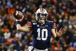 Auburn quarterback Bo Nix throws a pass during the second half of the team's NCAA college football game against Mississippi, Saturday, Nov. 2, 2019, in Auburn, Ala. (AP Photo/Butch Dill)