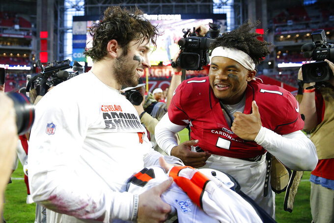 FILE - In this Dec. 15, 2019, file photo, Arizona Cardinals quarterback Kyler Murray (1) greets Cleveland Browns quarterback Baker Mayfield after an NFL football game in Glendale, Ariz. Back-to-back Heisman Trophies at Oklahoma followed, then No. 1 overall draft picks and now NFL fame as starting quarterbacks, Murray and Mayfield are forever linked. On Sunday, their close friendship gets put on hold. (AP Photo/Rick Scuteri, File)