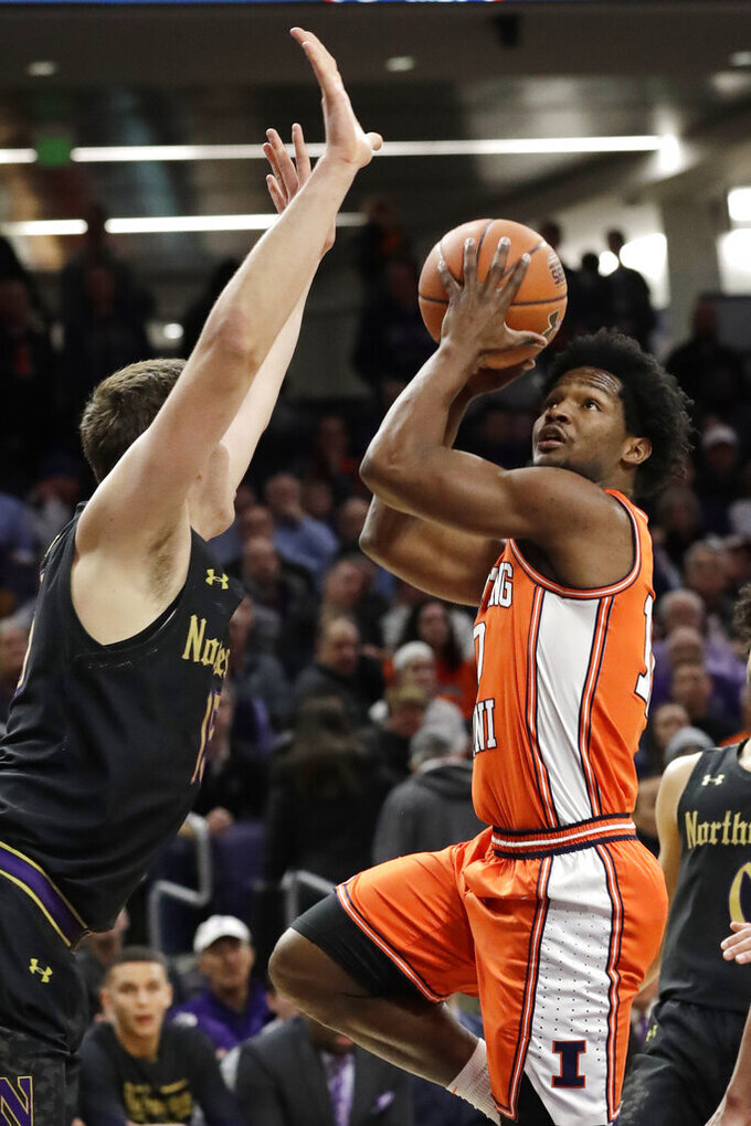 Illinois guard Andres Feliz, right, shoots against Northwestern center Ryan Young during the first half of an NCAA college basketball game in Evanston, Ill., Thursday, Feb. 27, 2020. (AP Photo/Nam Y. Huh)