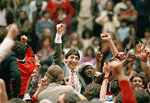 FILE - In this April 4, 1983, file photo, North Carolina State coach Jim Valvano, center with fist raised, celebrates after the team's win over Houston to win the NCAA men's basketball tournament championship in Albuquerque, N.M. This season's tournament, like all before them, would've been filled with dozens of legends in the making and diamonds in the rough _ with teams that overcame adversity to get this far and superfans who inspired the country every bit as much as their team. (AP Photo, File)