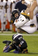 California quarterback Chase Garbers, top, gets upended by TCU safety Vernon Scott (26) during the first half of the Cheez-It Bowl NCAA college football game Wednesday, Dec. 26, 2018, in Phoenix. (AP Photo/Ross D. Franklin)