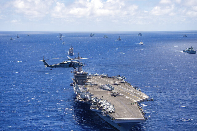 FILE -- In this July 26, 2018, file photo provided by the U.S. Navy, the aircraft carrier USS Carl Vinson participates in a group sail during the Rim of the Pacific exercise off the coast of Hawaii. The U.S. Navy says it will host the world's largest maritime exercises in Hawaii again this year, but the drills will only be held at sea because of the coronavirus. (Petty Officer 1st Class Arthurgwain L. Marquez/U.S. Navy via AP, File)