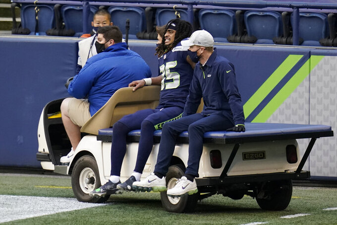 Seattle Seahawks cornerback Ryan Neal leaves the field on a cart after an injury during the second half of an NFL football game against the New York Giants, Sunday, Dec. 6, 2020, in Seattle. (AP Photo/Elaine Thompson)