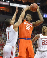 Clemson center Trey Jemison (55) shoots over the defense of Louisville guard Christen Cunningham (1) during the first half of an NCAA college basketball game in Louisville, Ky., Saturday, Feb. 16, 2019. (AP Photo/Timothy D. Easley)