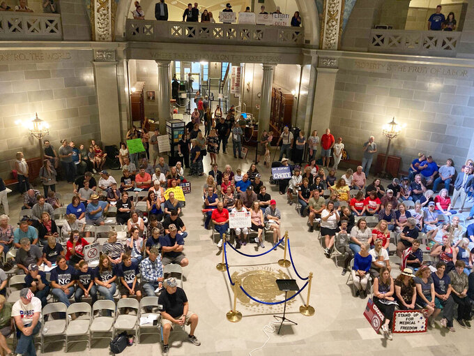 Missouri opponents rally Wednesday, Sept. 15, 2021, in the Capitol rotunda in Jefferson City, Missouri, against President Joe Biden's plan to require that businesses with 100 or more employees order their workers to be fully vaccinated or submit a negative COVID-19 test at least weekly. (AP Photo/Summer Ballentine)