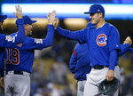 Chicago Cubs' Anthony Rizzo, right, celebrates with bench coach Mark Loretta (19) after the Cubs defeated the Los Angeles Dodgers 2-1 in a baseball game in Los Angeles, Saturday, June 15, 2019. (AP Photo/Alex Gallardo)