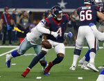 Houston Texans quarterback Deshaun Watson (4) is sacked by Dallas Cowboys' Taco Charlton, rear, in the first half of a preseason NFL football game in Arlington, Texas, Saturday, Aug. 24, 2019. Watson fumbled the ball on the sack and Dallas recovered. (AP Photo/Ron Jenkins)