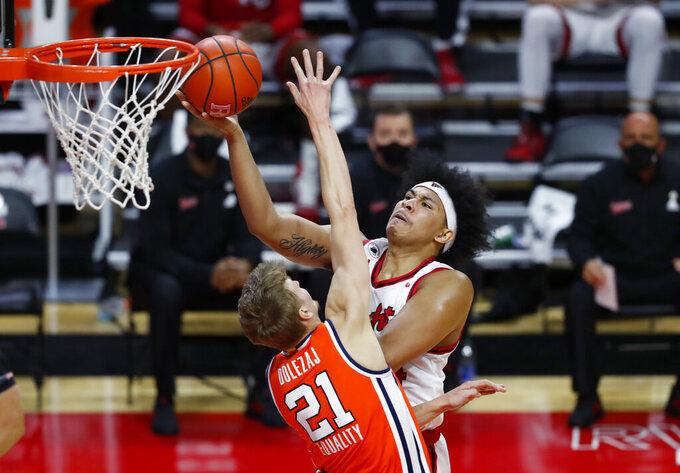 Rutgers' Ron Harper Jr. goes to the basket against Syracuse forward Marek Dolezaj (21) during the second half of an NCAA college basketball game in Piscataway, N.J., Tuesday, Dec. 8, 2020. (AP Photo/Noah K. Murray)