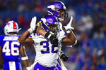 Minnesota Vikings running back De'Angelo Henderson (32) celebrates his touchdown with offensive guard Dru Samia, rear, during the second half of an NFL preseason football game against the Buffalo Bills in Orchard Park, N.Y., Thursday, Aug. 29, 2019. (AP Photo/David Dermer)